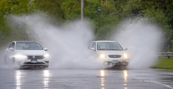 Traffic ran through flooded areas along Shepard Road and Homer Street in St. Paul Thursday, September 12, 2019. The Twin Cities could see one to two i