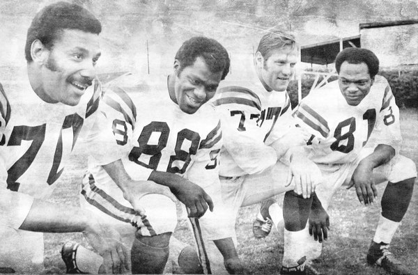 The 1969 Vikings defensive line -- Jim Marshall, Alan Page, Gary Larsen and Carl Eller -- was known as the Purple People Eaters. This photo was taken