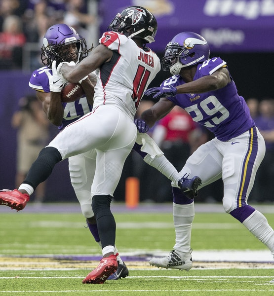 Vikings safety Anthony Harris (41) often found himself in the right place at the right time against Atlanta on Sunday, including on the first of his t
