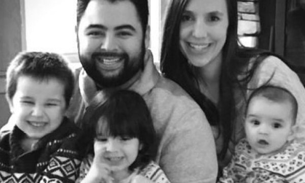 Javier Sanmiguel with his wife and three of four children.