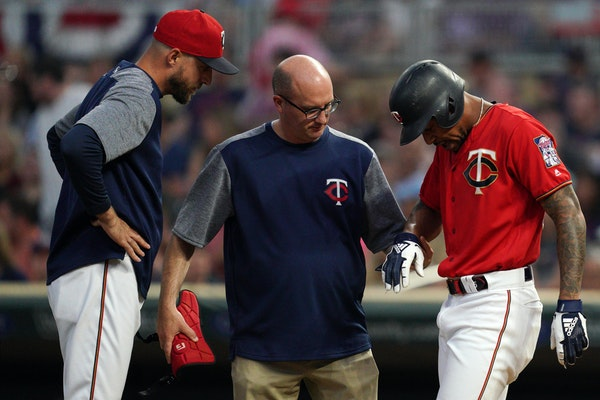 Twins center fielder Byron Buxton was checked by trainer Tony Leo and manager Rocco Baldelli after Buxton was hit in the hand while batting Friday. Bu