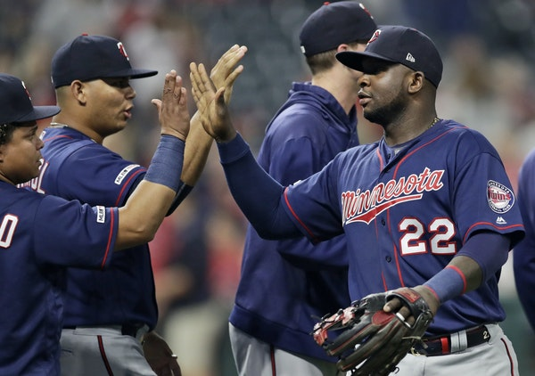 Miguel Sano was congratulated by Twins teammates after they defeated the Indians in Game 2 Saturday, thanks greatly to his g rand slam in the eighth i