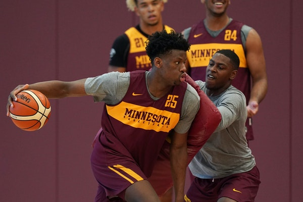 Gophers center Daniel Oturu (25) took part in a drill during a practice in early August.