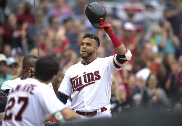 The Twins' Nelson Cruz acknowledged the cheering crowd as he celebrated his 40th home run of the season, and his 400th career homer, a 412 foot solo s