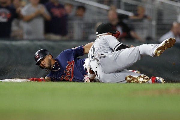Eddie Rosario (20) was tagged out at third base by Chicago White Sox third baseman Yoan Moncada (10) when he tried to stretch a double into a triple w