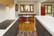 """AFTER In the breakfast nook, a new bench beneath the existing bay window """"gives the wall a purpose — and more seating,"""" said architect Meghan Ke"""