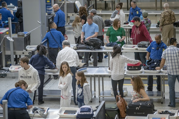 Travelers made their way through security at MSP Terminal 1.