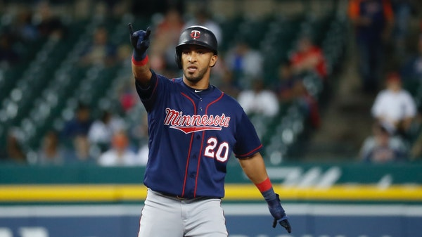 Eddie Rosario celebrated hitting a two-run double in the seventh inning in Detroit.