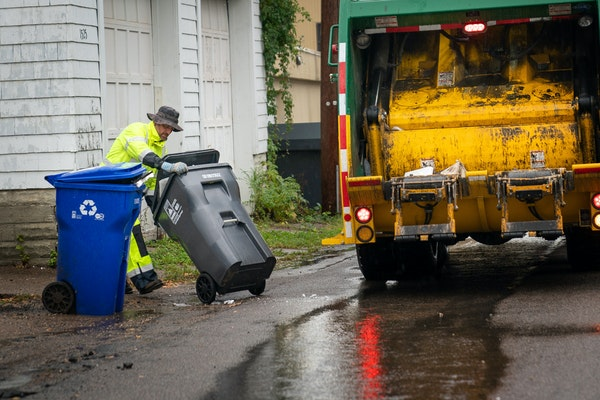 Waste Management worker Daniel Westerhaus collected trash from the alleys of the Snelling Hamline neighborhood of St Paul's yellow zone on the first d