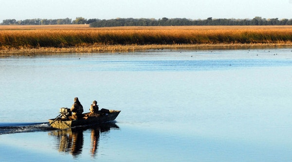 Dakotans say they can tell Minnesota duck hunters from locals because Minnesotans frequently travel by boat, as Dennis Anderson's sons did as teenag