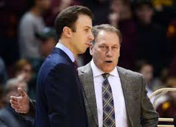 Gophers coach Richard Pitino, left, and Michigan State coach Tom Izzo found their teams at opposite ends of the unofficial Big Ten media's preseason b