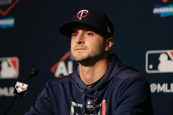 Twins starting pitcher Jake Odorizzi talks to reporters during a news conference during the ALDS.