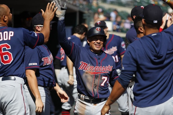 Minnesota Twins' Ronald Torreyes, center, is congratulated in the dugout after scoring in the third inning of a baseball game against the Detroit Tige