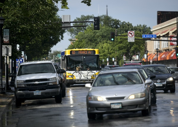 Traffic moved along Hennepin Avenue near W. 24th Street during an evening commute.