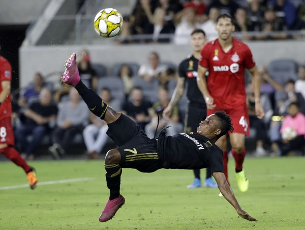 Los Angeles FC's Latif Blessing shoots on a bicycle kick against Toronto FC during the second half of their match Sept. 21 in Los Angeles. The teams p