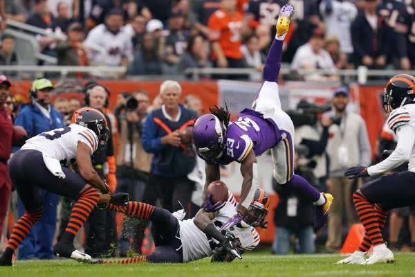 Dalvin Cook of the Vikings was upended by Bears safety Ha Ha Clinton-Dix (21) at Soldier Field on Sunday.