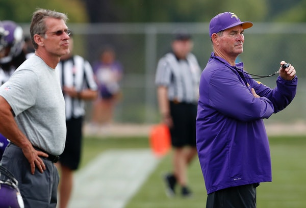 Vikings general manager Rick Spielman and head coach Mike Zimmer