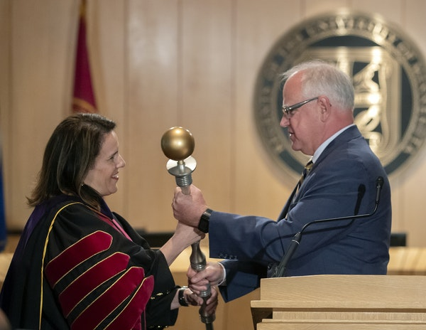 """Gov. Tim Walz at last month's inauguration of University of Minnesota President Joan Gabel. Walz on Tuesday said he is """"certainly willing to look at"""