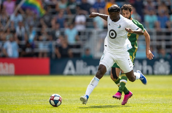 Minnesota FC defender Ike Opara (3) attempted to regain control of the ball against Portland in the first half of a match on Aug. 4 at Allianz Field.