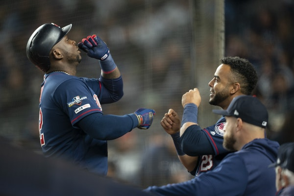 Minnesota Twins third baseman Miguel Sano, left, celebrated his sixth inning solo home run in Game 1 with teammate Nelson Cruz when he returned to the