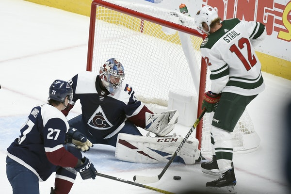 Wild center Eric Staal (12) searched for the puck as Avalanche goalie Philipp Grubauer defended Saturday in Denver.