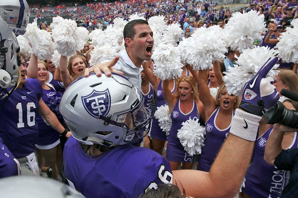 University of St. Thomas head football coach Glenn Caruso celebrated with his team after defeating St. John's in 2017 at Target Field.