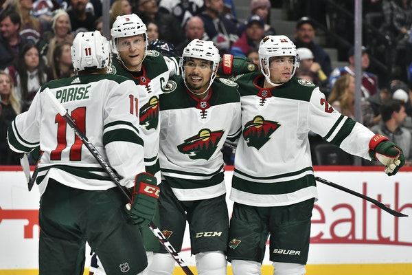 Matt Dumba celebrated with teammates after his power play shot was deflected in for a goal by teammate Zach Parise on Saturday night in Colorado.