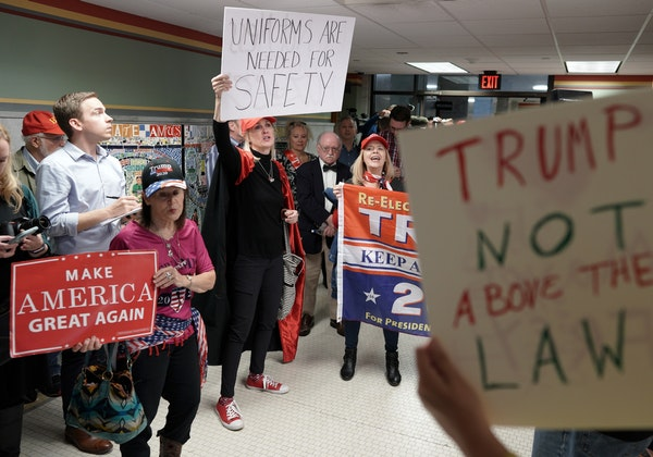 """A group of about 30 pro Trump supporters gathered for a rallying at noon Wednesday outside Mayor Jacob Frey's office in City Hall, to show """"how disple"""