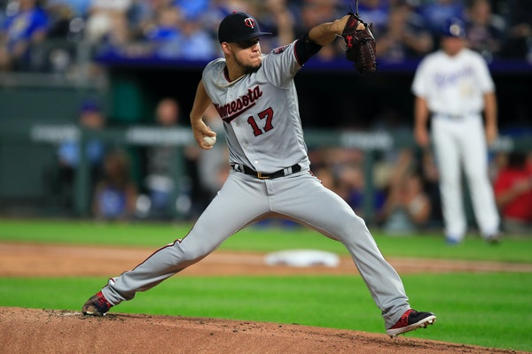 Twins starting pitcher Jose Berrios delivers to a Kansas City batter during the first inning