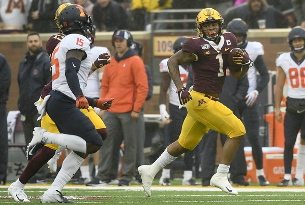Gophers running back Rodney Smith broke free for a first down, on a modest gain by Saturday's standards.