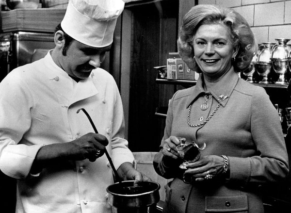 Charlie's Cafe Exceptionale owner Louise Saunders in the kitchen with executive chef George Lisovkis in 1976.