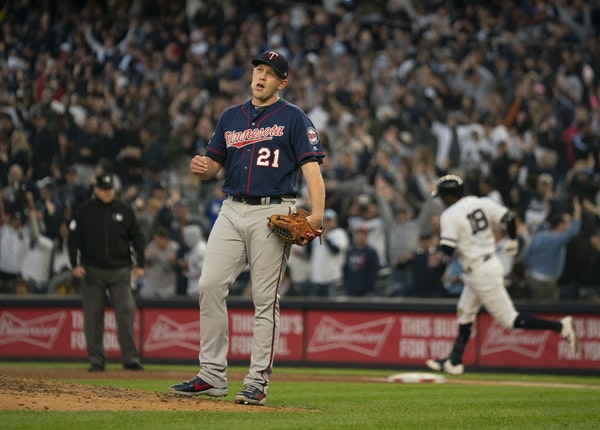 Pictured above Reliever Tyler Duffey reacted after Yankees SS Didi Gregorius, rear, knocked a grand slam in the third inning.