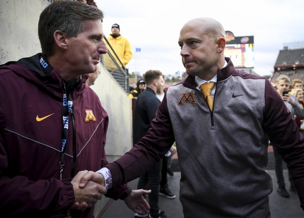 Gophers football coach P.J. Fleck shook hands with AD Mark Coyle following the victory over Illinois this season.