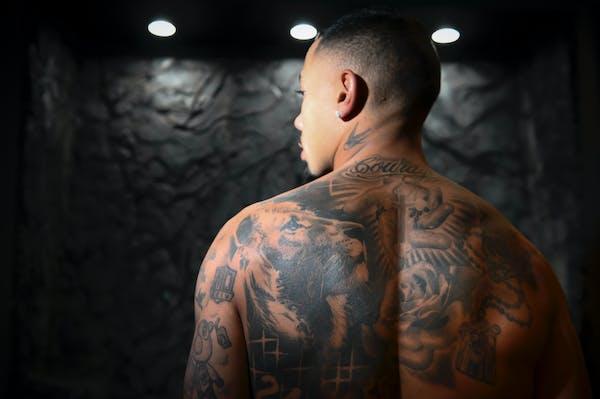 Wild defenseman Matt Dumba stood for a portrait at Leviticus Tattoo and Body Piercing in Minneapolis