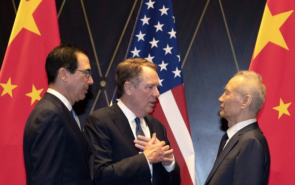 FILE - In this July 31, 2019, file photo U.S. Trade Representative Robert Lighthizer, center, gestures as he chats with Chinese Vice Premier Liu He, a