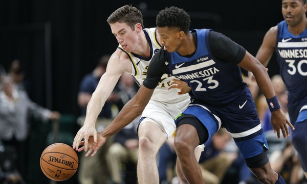 Wolves rookie Jarrett Culver challenged the Pacers' T.J. Leaf for the ball during the second half Tuesday in Indianapolis.