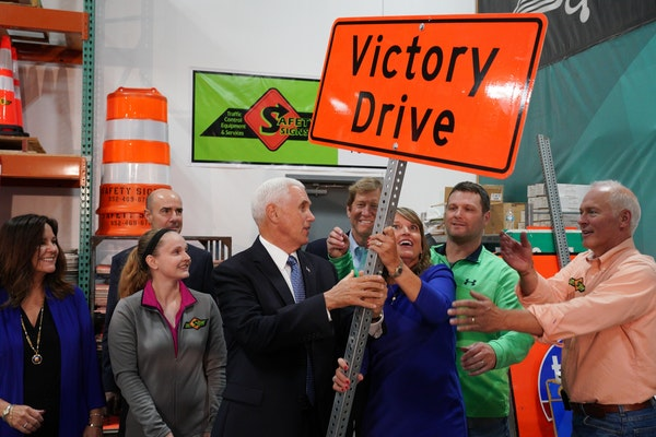 Safety Signs vice president Jay Blanchard, right, his wife, company president Sue Blanchard, and U.S. Vice President Mike Pence, laughed as they tried