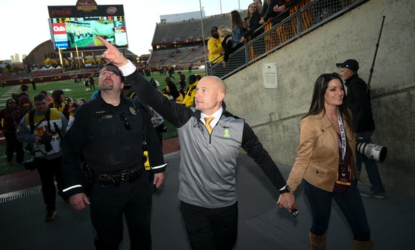 Gophers head coach P.J. Fleck held his wife Heather's hand as he greeted fans after his teams' 52-10 win over Maryland. ] Aaron Lavinsky • aaron.lav