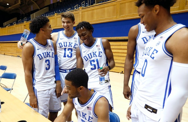 Duke's Tre Jones (3) laughs with Joey Baker (13), Mike Buckmire (51), Cassius Stanley (2), and Wendell Moore (0) during media day at Cameron Indoor St