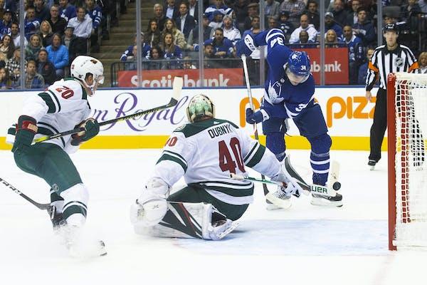The Maple Leafs' Auston Matthews, right, scored on Wild goaltender Devan Dubnyk during Toronto's four-goal second period Tuesday.