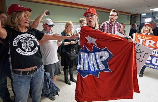 """A group of about 30 Trump supporters gathered for a rally at noon Wednesday outside Mayor Jacob Frey's office in City Hall, to show """"how displeased th"""