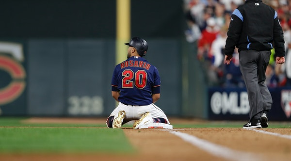 Eddie Rosario later hit a home run to get the Twins close, but he remained on his knees after being thrown out at first base in the fifth inning of th