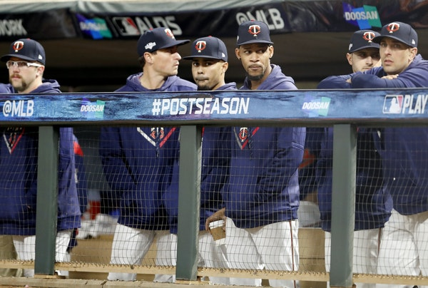 Twins players, including injured center fielder Byron Buxton (middle), wore some grim faces during the ninth inning of an ALDS Game 3 loss to the Yank