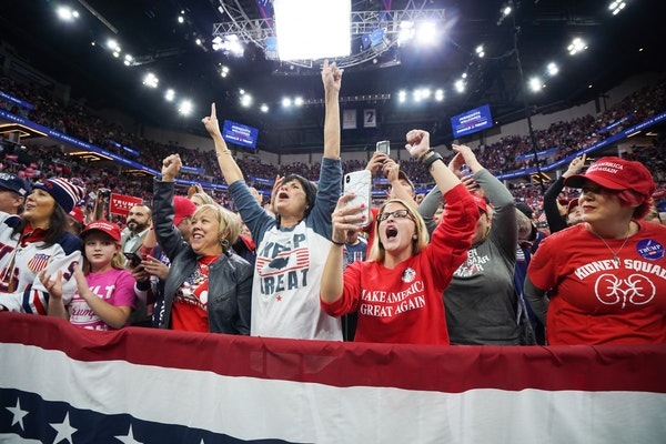 President Donald Trump greeted cheering crowds at the Target Center in Minneapolis, Minnesota.