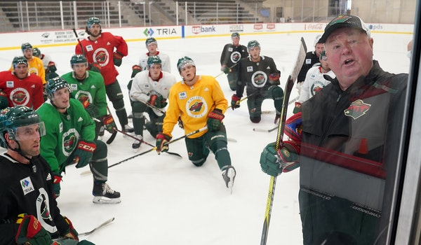 Wild players listened as head coach Bruce Boudreau spoke during a practice on Sept 13.