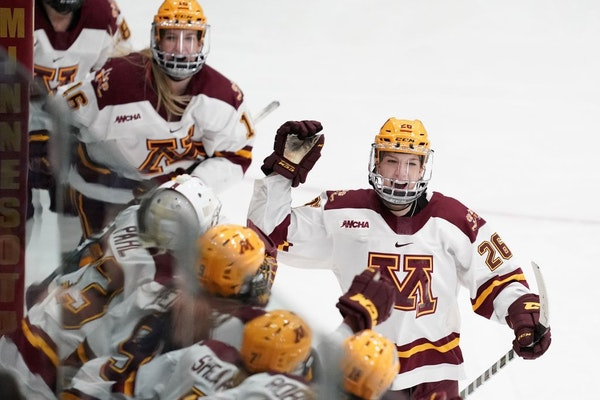 Minnesota Golden Gophers forward Sarah Potomak (26) celebrated with her teammates on the bench after she scored a goal on Wisconsin Badgers goaltender
