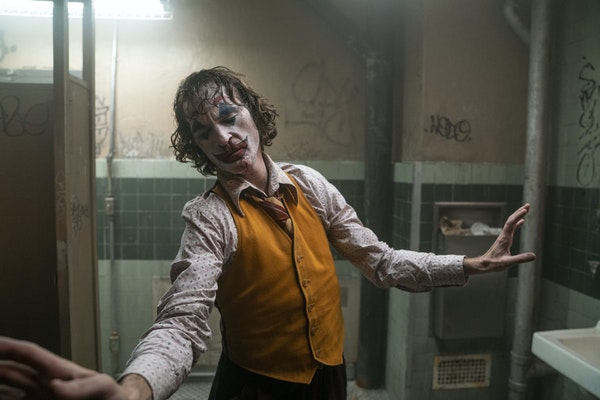 """This image released by Warner Bros. Pictures shows Joaquin Phoenix in a scene from the film, """"Joker."""" (Niko Tavernise/Warner Bros. Pictures via AP"""