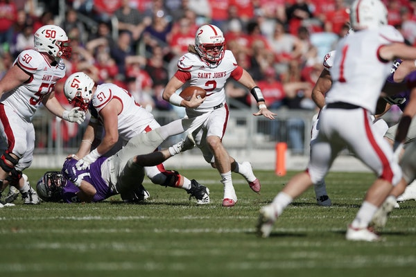 St. John's quarterback Jackson Erdmann drove through St. Thomas' defense in the second quarter.