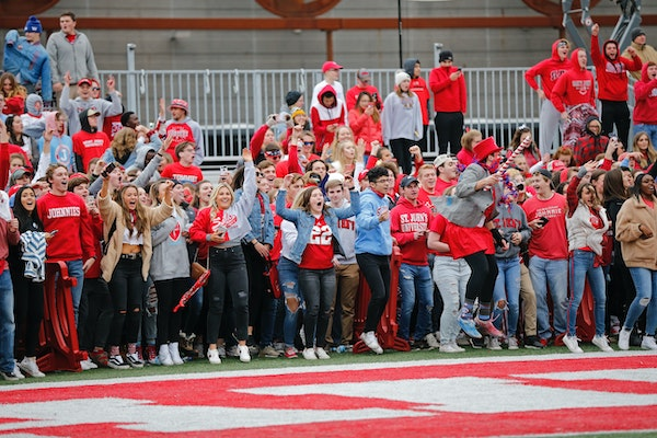 St. John's fans waited for the game clock to run out before rushing onto the field after the Johnnies topped the Tommies 40-20 last fall. The football