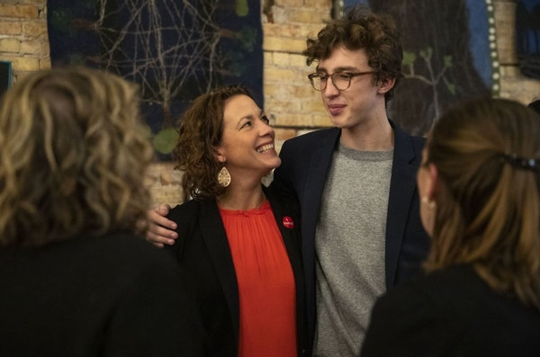 Duluth incumbent Mayor Emily Larson talked with her son, Eli Zaun, during her watch party at the Duluth Folk School on Tuesday night.